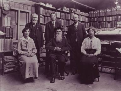 This photo (from the OED archives) was taken on Murray's last day in his Scriptorium, 10 July 1915. Left to right, seated: Elsie M. R. Murray, James A. H. Murray, Rosfrith A. N. R. Murray; standing: A. J. Maling, F. J. Sweatman, F. A. Yockney.